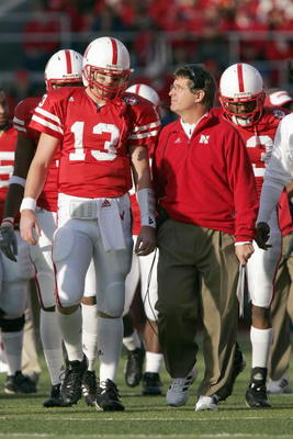 LINCOLN, NE - NOVEMBER 24:  Quarterback Zac Taylor #13 of the Nebraska Cornhuskers listens to head coach Bill Callahan before the game against the Colorado Buffaloes on November 24, 2006 at Memorial Stadium in Lincoln, Nebraska. Nebraska won 37-14. (Photo