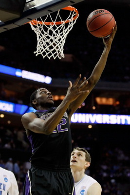 CHARLOTTE, NC - MARCH 20:  Justin Holiday #22 of the Washington Huskies lays the ball up against the North Carolina Tar Heels in the second half during the third round of the 2011 NCAA men's basketball tournament at Time Warner Cable Arena on March 20, 20