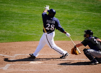 PHOENIX, AZ - MARCH 10:  Prince Fielder#28 of the Milwaukee Brewers hits a base hit against the Colorado Rockies in the third inning of the spring training baseball game at Maryvale Baseball Park on March 10, 2011 in Phoenix, Arizona.  (Photo by Kevork Dj