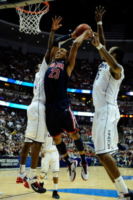 ANAHEIM, CA - MARCH 26:  Derrick Williams #23 of the Arizona Wildcats dunks the ball against Roscoe Smith #22 and Charles Okwandu #35 of the Connecticut Huskies during the west regional final of the 2011 NCAA men's basketball tournament at the Honda Cente