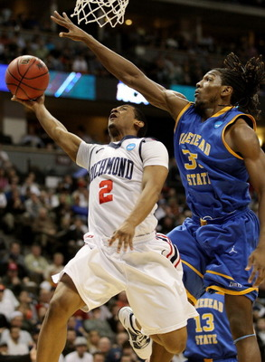DENVER, CO - MARCH 19:  Kenneth Faried #35 of the Morehead State Eagles goes up to contest the shot of Cedrick Lindsay #2 of the Richmond Spiders during the third round of the 2011 NCAA men's basketball tournament at Pepsi Center on March 19, 2011 in Denv