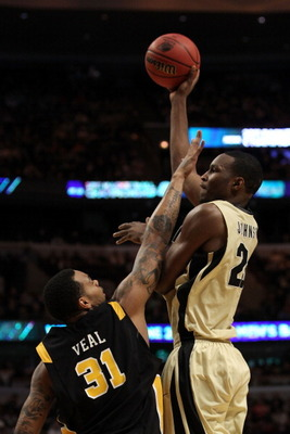 CHICAGO, IL - MARCH 20:  JaJuan Johnson #25 of the Purdue Boilermakers shoots against Toby Veal #31 of the Virginia Commonwealth Rams in the first half during the third round of the 2011 NCAA men's basketball tournament at the United Center on March 20, 2