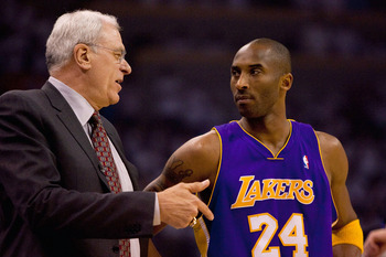 OKLAHOMA CITY - APRIL 24: Head coach Phil Jackson and Kobe Bryant #24 of the Los Angeles Lakers talk prior to playing against the Oklahoma City Thunder during Game Four of the Western Conference Quarterfinals of the 2010 NBA Playoffs on April 24, 2010 at
