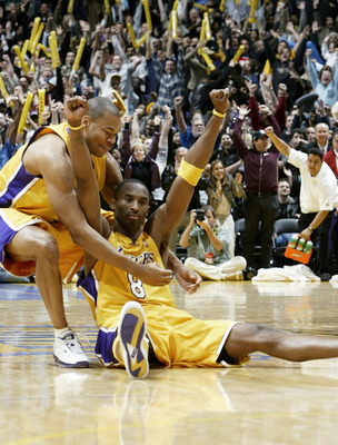 LOS ANGELES - DECEMBER 19: Kobe Bryant #8 of the Los Angeles Lakers celebrates with Devean George #3 after hitting the winning shot at the buzzer in the game against the Denver Nuggets on December 19, 2003 at Staples Center in Los Angeles, California. The