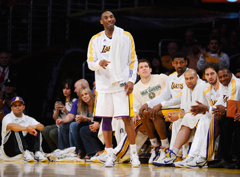 LOS ANGELES, CA - APRIL 03:  Kobe Bryant #24 of the Los Angeles Lakers reacts from the bench during the game against Denver Nuggets at Staples Center on April 3, 2011 in Los Angeles, California. NOTE TO USER: User expressly acknowledges and agrees that, b