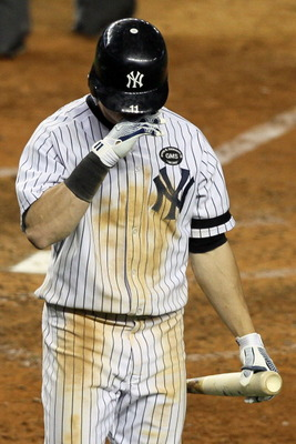 NEW YORK - OCTOBER 18:  Brett Gardner #11 of the New York Yankees reacts after striking out against the Texas Rangers in Game Three of the ALCS during the 2010 MLB Playoffs at Yankee Stadium on October 18, 2010 in New York, New York.  (Photo by Jim McIsaa