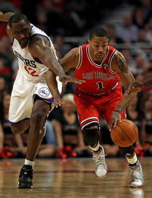 CHICAGO, IL - MARCH 28: Derrick Rose #1 of the Chicago Bulls and Elton Brand #42 of the Philadelphia 76ers chase down a loose ball at the United Center on March 28, 2011 in Chicago, Illinois. The 76ers defeated the Bulls 97-85. NOTE TO USER: User expressl