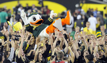 EUGENE, OR - OCTOBER 2: Puddles the Oregon Duck mascot is carried on the shoulders of fans on the feild of Autzen Stadium after the Oregon Ducks beat the Stanford Cardinal 52-31 at Autzen Stadium on October 2, 2010 in Eugene, Oregon. (Photo by Steve Dykes