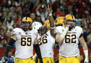 TUCSON, AZ - DECEMBER 02:  Runningback Cameron Marshall #26 of the Arizona State Sun Devils celebrates after scoring a 2 yard rushing touchdown against the Arizona Wildcats during the double overtime of the college football game at Arizona Stadium on Dece