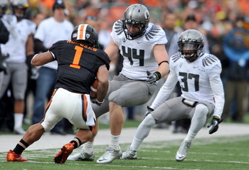 CORVALLIS, OR - DECEMBER 4: Brandon Hanna #44 and Talmadge Jackson III #37 of the Oregon Ducks close in on Jacquizz Rodgers #1 of the Oregon State Beavers in the second quarter of the game at Reser Stadium on December 4, 2010 in Corvallis, Oregon. The Duc