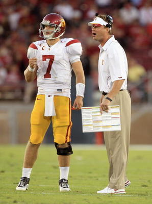 PALO ALTO, CA - OCTOBER 09:  Matt Barkley #7 of the USC Trojans speaks with head coach Lane Kiffin during their game against the Stanford Cardinal at Stanford Stadium on October 9, 2010 in Palo Alto, California.  (Photo by Ezra Shaw/Getty Images)