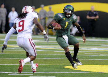 EUGENE, OR - OCTOBER 2: Quarterback Darron Thomas #1 of the Oregon Ducks makes a move on cornerback Richard Sherman #9 of Stanford as he runs with the ball in the first quarter of the game at Autzen Stadium on October 2, 2010 in Eugene, Oregon. (Photo by