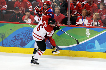 VANCOUVER, BC - FEBRUARY 24:  Shea Weber #6 of Canada collides with Alexander Ovechkin #8 of Russia during the ice hockey men's quarter final game between Russia and Canada on day 13 of the Vancouver 2010 Winter Olympics at Canada Hockey Place on February