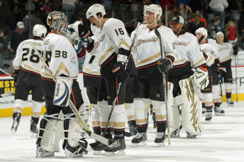 DENVER, CO - MARCH 11:  Goalie Dan Ellis #38 of the Anaheim Ducks celebrates with George Parros #16 and their teammates after their victory over the Colorado Avalanche during NHL action at the Pepsi Center on March 11, 2011 in Denver, Colorado. Ellis earn