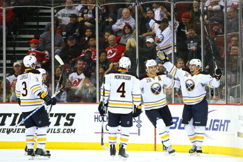 NEWARK, NJ - OCTOBER 23:  Patrick Kaleta #36 of the Buffalo Sabres (R) celebrates with teammates after scoring against the New Jersey Devils in the second period on October 23, 2010 at the Prudential Center in Newark, New Jersey.  (Photo by Andrew Burton/