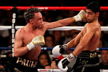 NEW YORK - MAY 15:   Paulie Malignaggi (L) hits Amir Khan of Great Britain during the WBA light welterweight title fight at Madison Square Garden on May 15, 2010 in New York City.  (Photo by Chris Trotman/Getty Images)