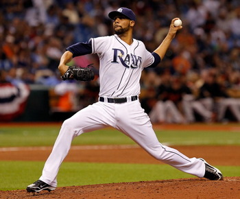 ST. PETERSBURG, FL - APRIL 01:  Pitcher David Price #14 of the Tampa Bay Rays pitches against the Baltimore Orioles during the Opening Day game at Tropicana Field on April 1, 2011 in St. Petersburg, Florida.  (Photo by J. Meric/Getty Images)