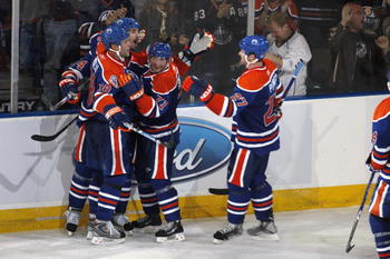 EDMONTON, CANADA - OCTOBER 12:  Ethan Moreau #18 of the Edmonton Oilers celebrates with teammates Sheldon Souray #44, Lubomir Visnovsky #71, and Dustin Penner #27 following his game winning goal with five seconds left in the game vs the  Colorado Avalanch