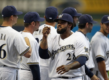 MILWAUKEE, WI - APRIL 04: Prince Fielder #28 of the Milwaukee Brewers greets teammates during player inrtoductions before the home opener against the Atlanta Braves at Miller Park on April 4, 2011 in Milwaukee, Wisconsin. The Braves defeated the Brewers 2