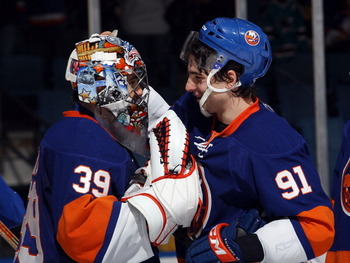 UNIONDALE, NY - JANUARY 15: Rick DiPietro #39 and John Tavares #91 of the New York Islanders celebrate their win over the Buffalo Sabres at the Nassau Coliseum on January 15, 2011 in Uniondale, New York. The Islanders defeated the Sabres 5-3. (Photo by Br