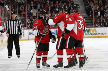 OTTAWA, CANADA - APRIL 5: Ryan Shannon #26 of the Ottawa Senators celebrates a goal with teamates Nick Foligno #71 and Erik Condra #38 against the Philadelphia Flyers at Scotiabank Place on April 5, 2011 in Ottawa, Ontario, Canada.  (Photo by Francois Lap