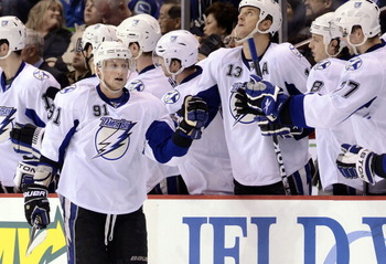 VANCOUVER, CANADA - DECEMBER 11:  Steven Stamkos #91 of the Tampa Bay Lightning is congratulated by teammates after scoring against the Vancouver Canucks during the second period in NHL action on December 11, 2010 at Rogers Arena in Vancouver, BC, Canada.