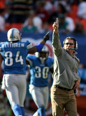 MIAMI - DECEMBER 26: Coach Jim Schwartz of the Detroit Lions celebrates a touchdown against the Miami Dolphins at Sun Life Stadium on December 26, 2010 in Miami, Florida. The Lions defeated the Dolphins 34-27.  (Photo by Marc Serota/Getty Images)
