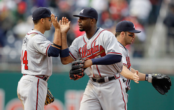 WASHINGTON, DC - APRIL 03: Martin Prado #14 of the Atlanta Braves and teammate Jason Heyward #22 celebrate after they defeated the Washington Nationals 11-2 at Nationals Park on April 3, 2011 in Washington, DC.  (Photo by Rob Carr/Getty Images)