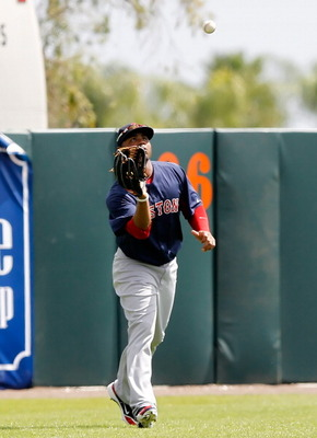 SARASOTA, FL - MARCH 05:  Outfielder Carl Crawford #13 of the Boston Red Sox catches a fly ball against the Baltimore Orioles during a Grapefruit League Spring Training Game at Ed Smith Stadium on March 5, 2011 in Sarasota, Florida.  (Photo by J. Meric/Ge