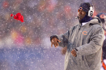 CHICAGO, IL - DECEMBER 12: Head coach Lovie Smith of the Chicago Bears throws his red flag to challenge an official's call against the New England Patriots at Soldier Field on December 12, 2010 in Chicago, Illinois.  The Patriots beat the Bears 36-7.  (Ph
