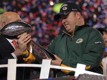 ARLINGTON, TX - FEBRUARY 06:  Head coach Mike McCarthy of the Green Bay Packers holds up The Vince Lombardi Trophy after the Green Bay Packers defeated the Pittsburgh Steelers 31 to 25 in Super Bowl XLV at Cowboys Stadium on February 6, 2011 in Arlington,