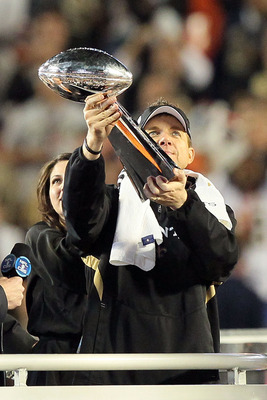 MIAMI GARDENS, FL - FEBRUARY 07: Head coach Sean Payton of the New Orleans Saints holds up the Vince Lombardi Trophy after defeating the Indianapolis Colts during Super Bowl XLIV on February 7, 2010 at Sun Life Stadium in Miami Gardens, Florida.  (Photo b