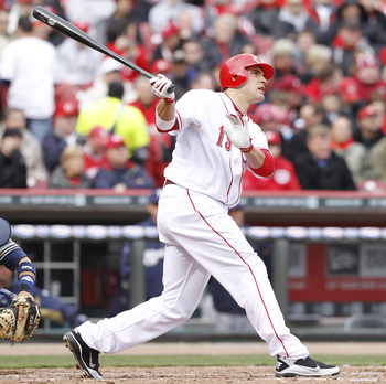 CINCINNATI, OH - MARCH 31: Joey Votto #19 of the Cincinnati Reds hits a home run in the seventh inning against the Milwaukee Brewers in the opening day game at Great American Ballpark on March 31, 2011 in Cincinnati, Ohio. The Reds won 7-6. (Photo by Joe