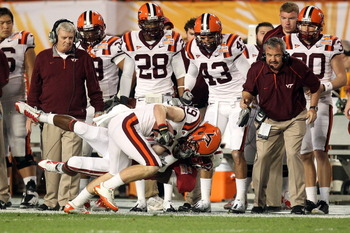 MIAMI, FL - JANUARY 03:  Danny Coale #19 of the Virginia Tech Hokies makes a reception in front of head coach Frank Beamer (L) the Stanford Cardinal during the 2011 Discover Orange Bowl at Sun Life Stadium on January 3, 2011 in Miami, Florida. Stanford wo