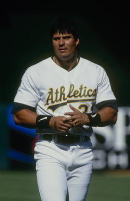 OAKLAND, CA - JUNE 29:  Jose Canseco of the Oakland Athletics looks on during the game against the Texas Rangers at Oakland-Alameda County Coliseum on June 29, 1997 in Oakland, California. (Photo by Otto Greule Jr/Getty Images)
