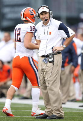 SEATTLE - SEPTEMBER 11:  Head coach Doug Marrone of the Syracuse Orange looks on as quarterback Ryan Nassib #12 comes off the field during the game against the Washington Huskies on September 11, 2010 at Husky Stadium in Seattle, Washington. (Photo by Ott
