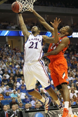 TULSA, OK - MARCH 20:  Markieff Morris #21 of the Kansas Jayhawks goes up for a shot against Mike Davis #24 of the Illinois Fighting Illini during the third round of the 2011 NCAA men's basketball tournament at BOK Center on March 20, 2011 in Tulsa, Oklah