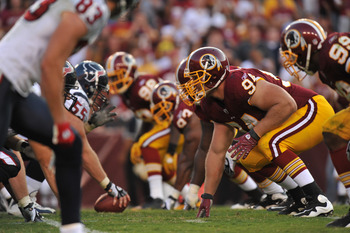 LANDOVER - SEPTEMBER 19:  Adam Carriker #94 of the Washington Redskins defends against the Houston Texans at FedExField on September 19, 2010 in Landover, Maryland. The Texans defeated the Redskins in overtime 30-27. (Photo by Larry French/Getty Images)