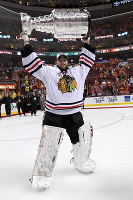 PHILADELPHIA - JUNE 09:  Antti Niemi #31 of the Chicago Blackhawks hoists the Stanley Cup after teammate Patrick Kane #88 scored the game-winning goal in overtime to defeat the Philadelphia Flyers 4-3 and win the Stanley Cup in Game Six of the 2010 NHL St