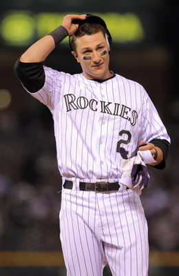 DENVER, CO - APRIL 05:  Troy Tulowitzki #2 of the Colorado Rockies retires his batting gear after flying out against the Los Angeles Dodgers at Coors Field on April 5, 2011 in Denver, Colorado. The Rockies defeated the Los Angeles Dodgers 3-0.  (Photo by