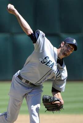 OAKLAND, CA - APRIL 3: Doug Fister #58 of the Seattle Mariners pitches against the Oakland Athletics during a MLB baseball game at the Oakland-Alameda County Coliseum April 3, 2011 in Oakland, California.  (Photo by Thearon W. Henderson/Getty Images)