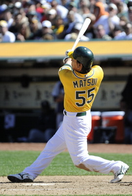 OAKLAND, CA - APRIL 3: Hideki Matsui #55 of the Oakland Athletics gets an rbi basehit in the seventh inning against the Seattle Mariners during a MLB baseball game at the Oakland-Alameda County Coliseum April 3, 2011 in Oakland, California.  (Photo by The
