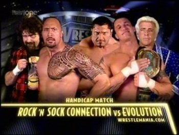 The_rock_and_mick_foley_vs_randy_orton_and_batista_and_ric_flair_display_image