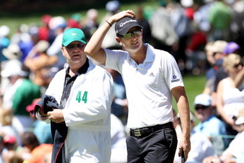 AUGUSTA, GA - APRIL 06:  Justin Rose of England looks on with his caddie during the Par 3 Contest prior to the 2011 Masters Tournament at Augusta National Golf Club on April 6, 2011 in Augusta, Georgia.  (Photo by Andrew Redington/Getty Images)