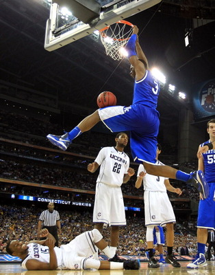 HOUSTON, TX - APRIL 02:  Terrence Jones #3 of the Kentucky Wildcats dunks the ball against Kemba Walker #15 of the Connecticut Huskies during the National Semifinal game of the 2011 NCAA Division I Men's Basketball Championship at Reliant Stadium on April