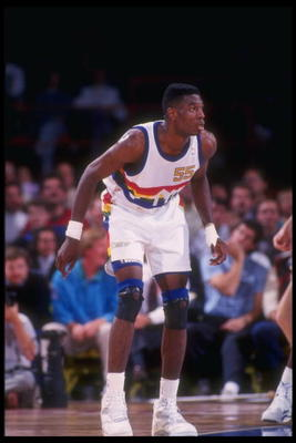 1991:  Center Dikembe Mutombo of the Denver Nuggets looks on during a game at the McNichols Sports Arena in Denver, Colorado. Mandatory Credit: Tim DeFrisco  /Allsport Mandatory Credit: Tim DeFrisco  /Allsport