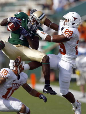 WACO, TX - NOVEMBER 14:  Inside receiver Kendall Wright #1 for the Baylor Bears pull in a pass against defensive back Clark Ford #29 for the Texas Longhorns in the second half on November 14, 2009 at Floyd Casey Stadium in Waco, Texas.  The Longhorns beat
