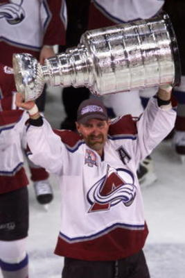 9 Jun 2001: Ray Bourque #77 of the Colorado Avalanche hoists the Stanley Cup after defeating the New Jersey Devils during the Stanley Cup finals at the Pepsi Center in Denver, Colorado. The Avalanche defeated the Devils 3-1 to win the series 4-3. DIGITAL