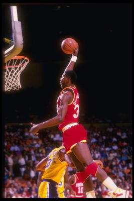 Center Hakeem Olajuwon of the Houston Rockets goes up for two during a game against the Los Angeles Lakers at The Summit in Houston, Texas.