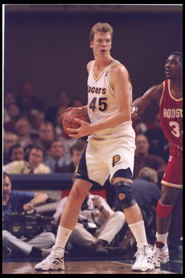 9 Nov 1994:  Center Rik Smits of the Indiana Pacers looks to pass the ball during a game against the Houston Rocket at Market Square Arena in Indianapolis, Indiana.  The Rockets won the game, 109-104. Mandatory Credit: Allsport  /Allsport